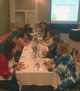 Maureen (front, left) joins in a speed mentoring session. (Photo courtesy of CWE)