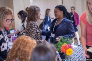 """Photo of """"Auntie"""" Anne Beiler and conference attendees courtesy of the Center for Women's Enterprise"""