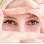 Woman narrowing her field of vision by framing hands around eyes
